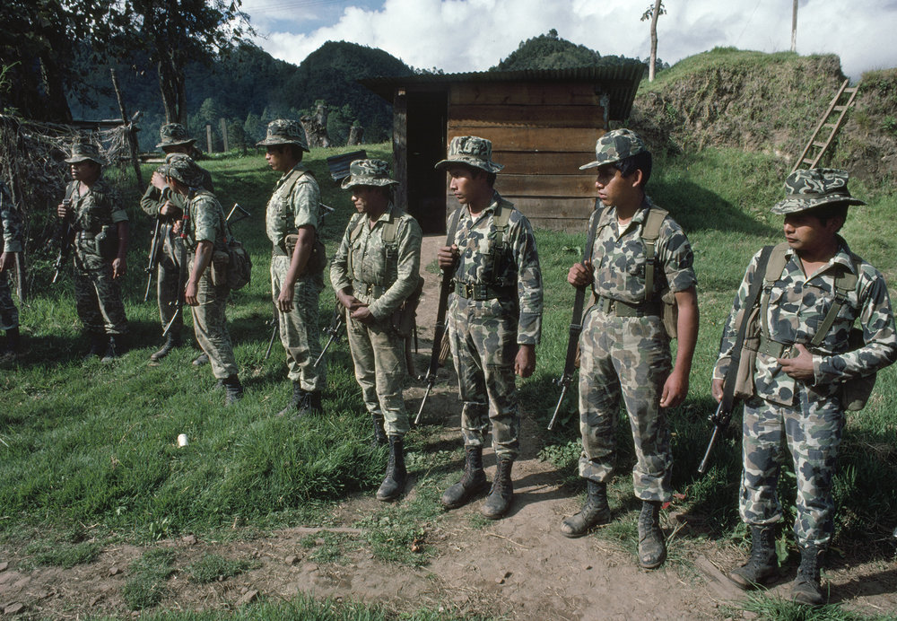 Guatemalan army soldiers listen to orders before moving out in search of leftist insurgents that attacked the army base one day earlier in San Juan Cotzal, Guatemala on January 20, 1982. On January 19, 1982, members of the Guerrilla Army of the Poor, EGP, attacked the army garrison in San Juan Cotzal with an estimated 300 insurgents killing 37 government soldiers.