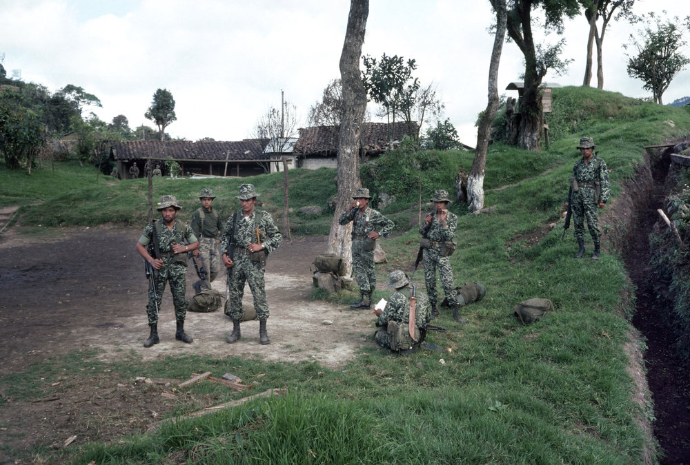 Guatemalan army soldiers rest before moving out in search of insurgents that attacked the army base one day earlier in San Juan Cotzal, Guatemala on January 20, 1982. On January 19, 1982, the Guerrilla Army of the Poor, EGP, attacked the army garrison in San Juan Cotzal with a reported 300 insurgents killing 37 government soldiers.