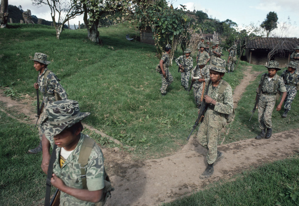 Guatemalan army soldiers move out in search of leftist insurgents that attacked the army base one day earlier on January 19, 1982 in San Juan Cotzal, Guatemala on January 20, 1982.