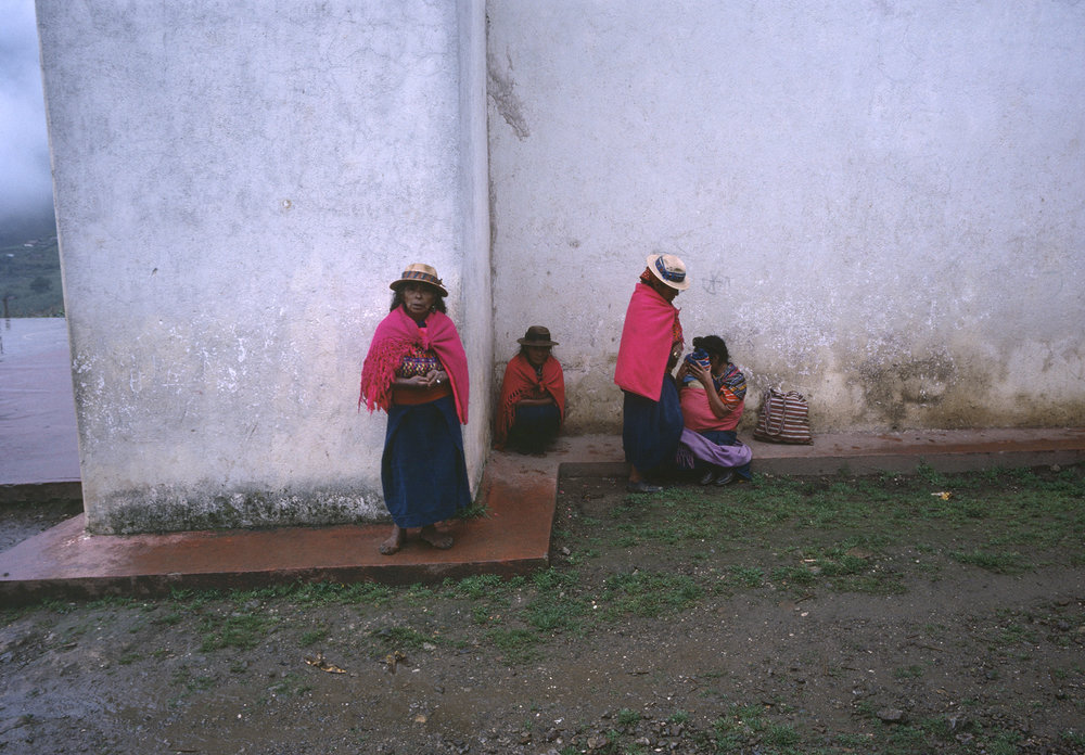 Mam speaking Mayan women sit next to a Roman Catholic church in rural Huehuetenango, Guatemala September 1, 1982. Rural highland residents were caught in a violent 36-year civil war between the Guatemalan army and leftist guerrilla groups.