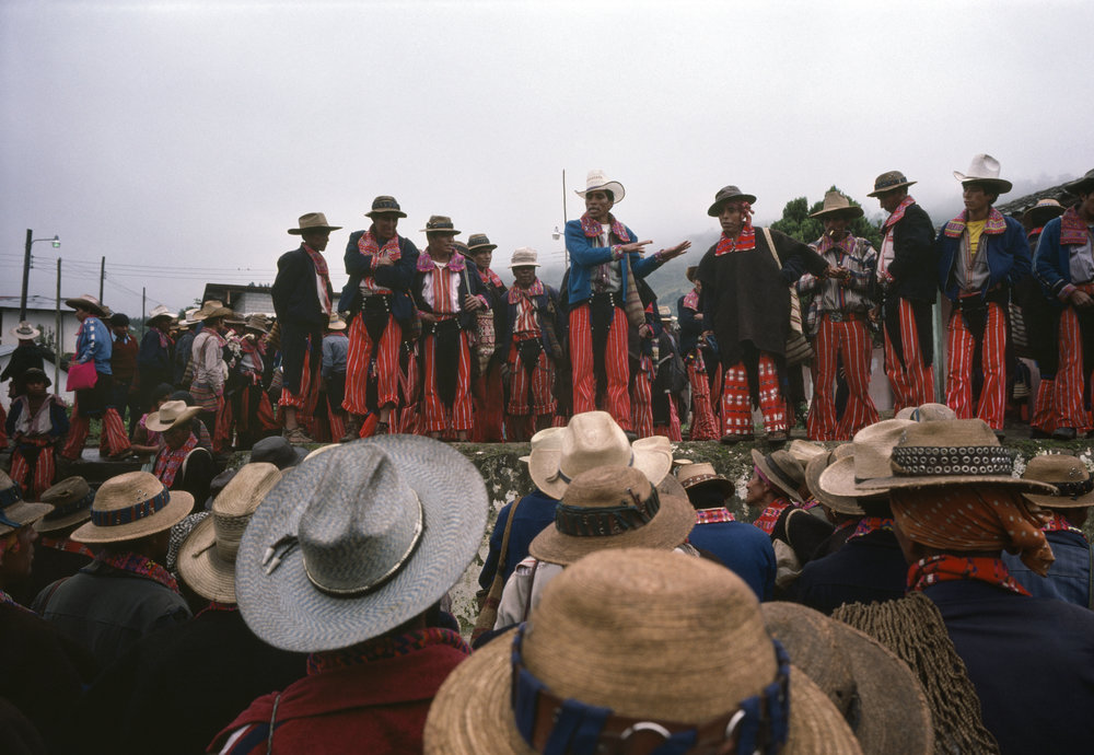 Local civil defense forces hold a meeting in the town square in Todos Santos, Guatemala on September 1, 1982. Local men would often be forced by guerrillas to hand over their rifles and come under the wrath of Guatemalan army officers.