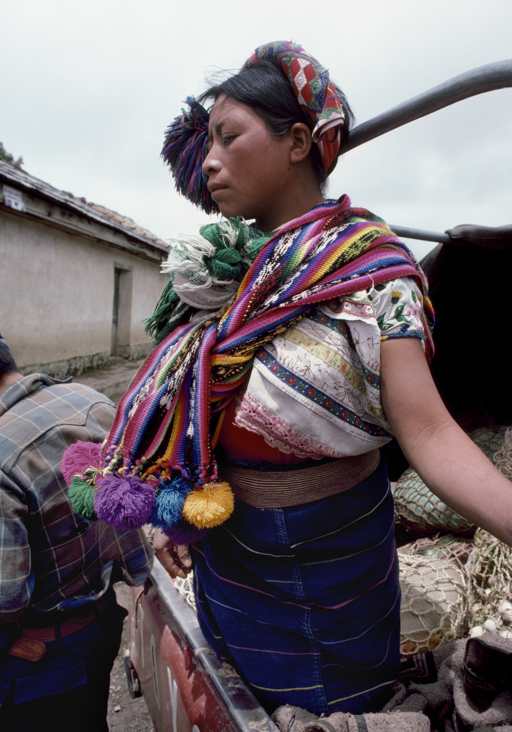 A Guatemalan woman stands in the back of a pick-up truck at a civil defense checkpoint in rural Huehuetenango, Guatemala on September 1, 1982.