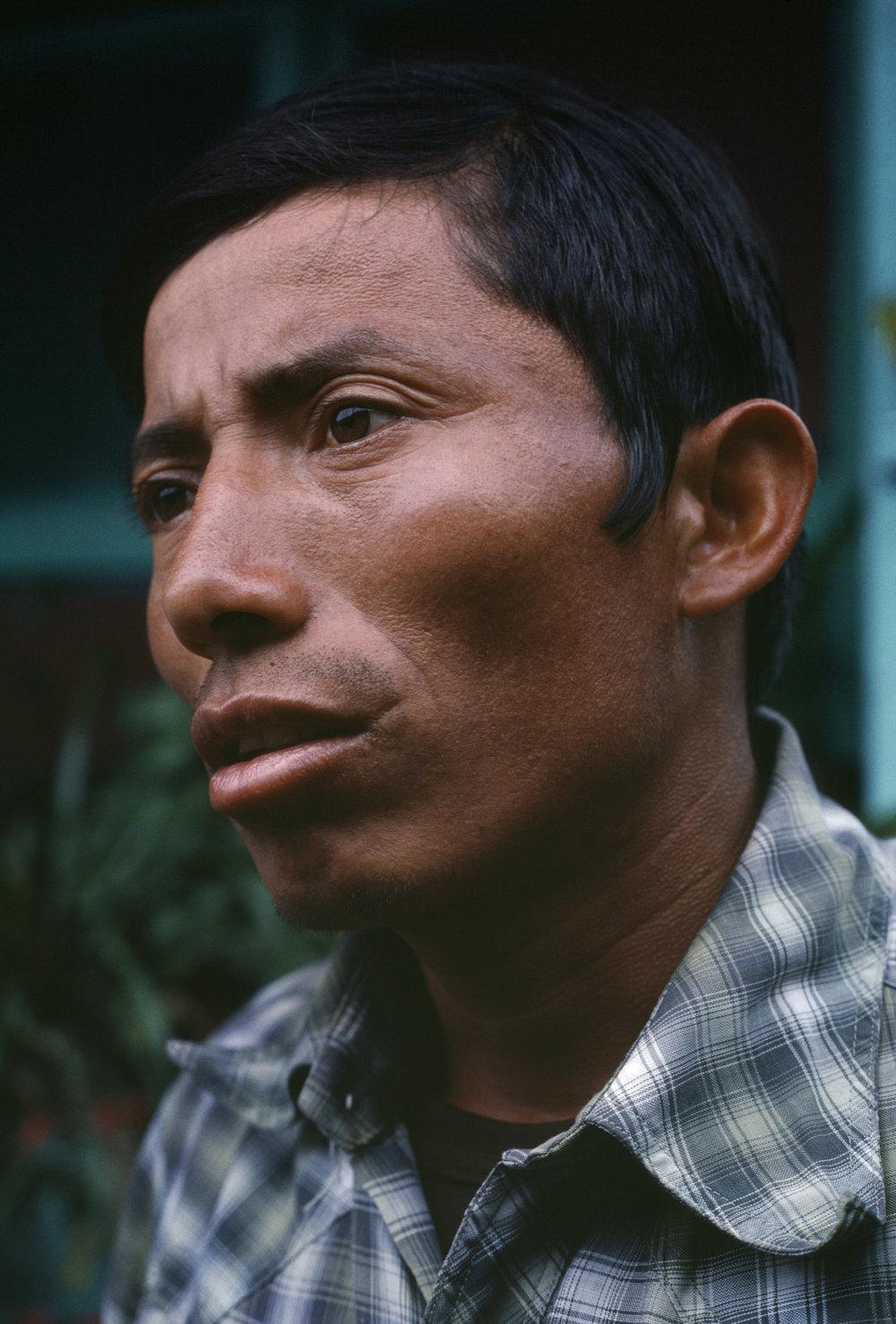 A local civil defenseman speaks to a reporter in rural Huehuetenango, Guatemala on September 1, 1982.