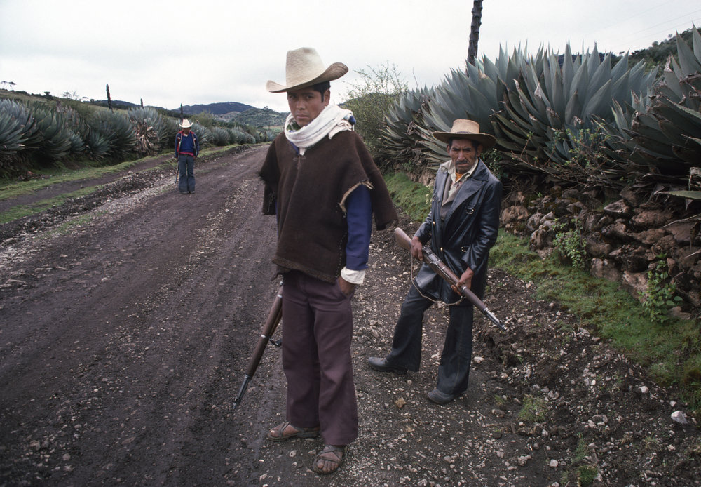 Local civil defense forces patrol along a mountain road in rural Huehuetenango, Guatemala on September 1, 1982. Civil defense groups were organized by the Guatemalan army to defend villages against armed attacks by leftist groups such as the Guerrilla Army of the Poor, EGP, the most active group fighting the Guatemalan military government during the 36-year civil war from 1960 to 1996.