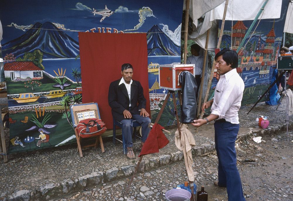 A local photographer prepares to take a picture in a rural town in Huehuetenango, Guatemala September 1, 1982.