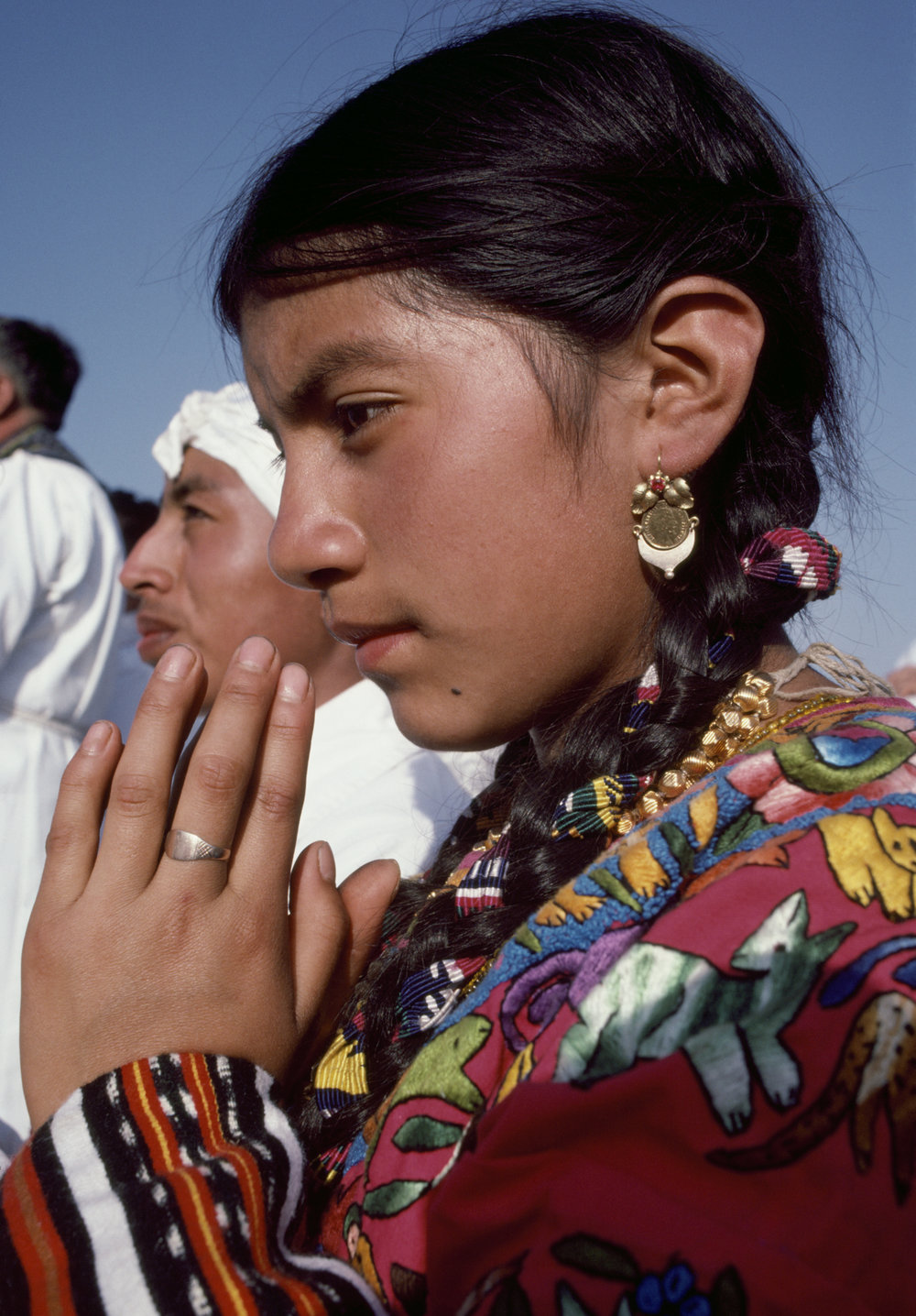An ethnic Maya woman prays during the visit of Pope John Paul ll in Guatemala City, Guatemala March 7, 1983. Pope John Paul ll arrived during the 36-year civil war where over 200,000 civilians were killed and 40,000 people went missing.