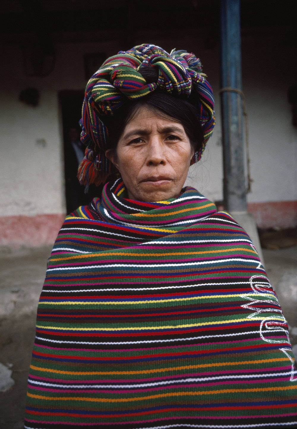 An Ixil Maya woman sits for a photograph inside the Pensíon Ardavin in Nebaj, Guatemala on January 1, 1984. Over 200,000 civilians were killed in the 36-year civil war with over 40,000 civilians missing, the majority of those were Ixil Mayan victims.