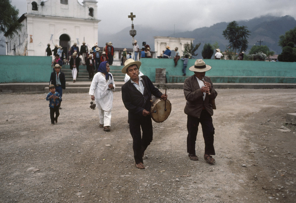Ixil Mayan men leave the central plaza following a Roman Catholic Church service in Nebaj, Guatemala on January 1, 1984. Over 200,000 civilians were killed in the 36-year civil war with over 40,000 civilians missing; the majority of those were Ixil Mayan.