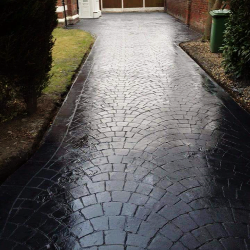 Imprinted concrete driveway in charcoal cobble for a customer in Stretford