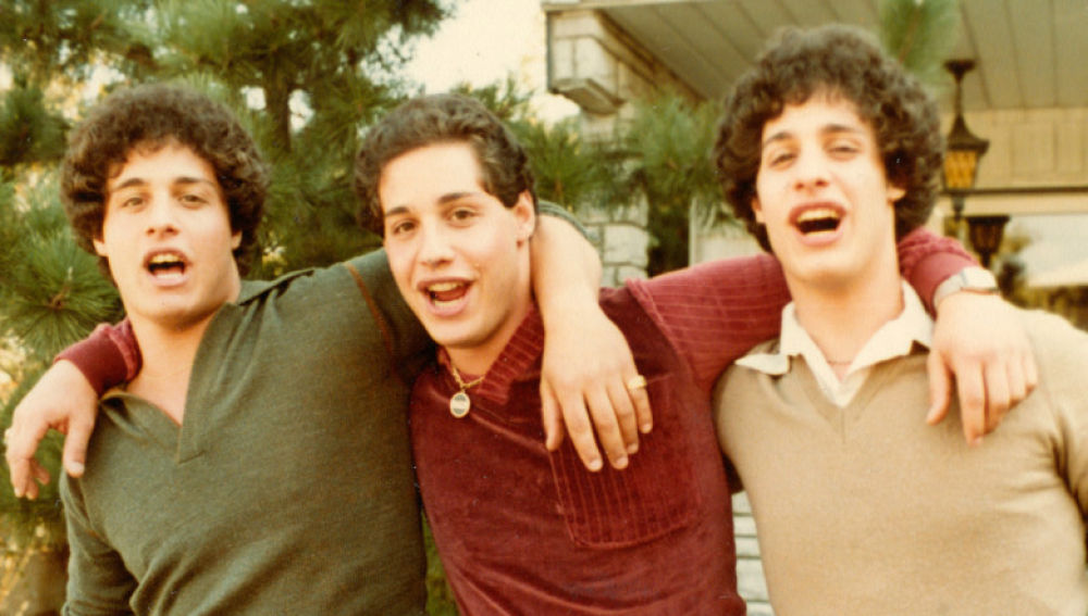 """Separated-at-birth brothers Eddy Galland, David Kellman and Bobby Shafran (from left), in their happy reunion phase, an image from the documentary """"Three Identical Strangers."""" (Photo courtesy Neon Films)"""