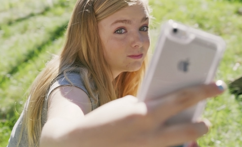 """Elsie Fisher stars as Kayla, navigating adolescence and social media in writer-director Bo Burnham's """"Eighth Grade."""" (Photo courtesy A24)"""