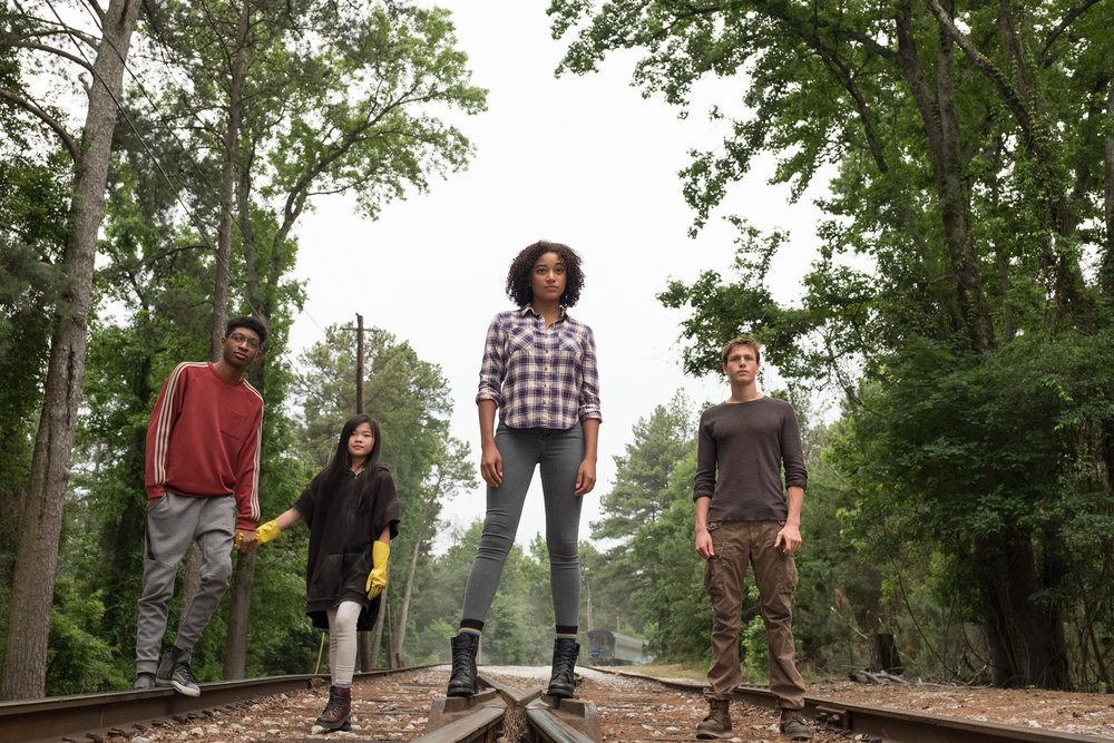 "Chubs (Skylan Brooks), Zu (Mia Cech), Ruby (Amandla Stenberg) and Liam (Harris Dickinson), from left, join forces in the dystopian adventure ""The Darkest Minds."" (Photo by Daniel McFadden, courtesy of 20th Century Fox)"