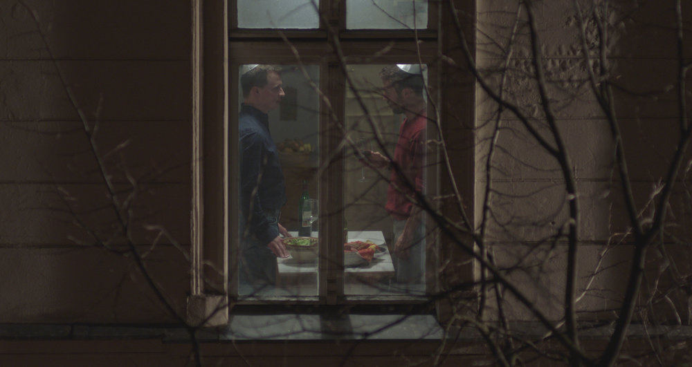 "Thomas (Tim Kalkhof, left), a Berlin baker, and Oren (Roy Miller), a businessman from Jerusalem, share a hidden romance in the drama ""The Cakemaker."" (Photo courtesy Strand Releasing)"