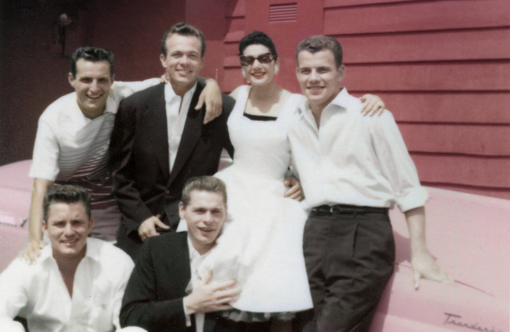 "Scotty Bowers (top row, in dark suit) poses with some of the hustlers he worked with in servicing Hollywood stars, as described in the documentary ""Scotty and the Secret History of Hollywood."" (Photo courtesy Greenwich Entertainment)"