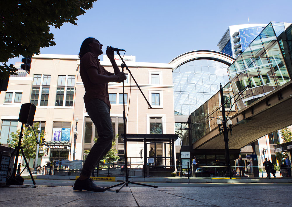 Singer/guitarist Dallin McAllister performs under the skybridge at Salt Lake City's City Creek Center, one of many buskers working around the city. (Photo by Rick Egan | The Salt Lake Tribune)