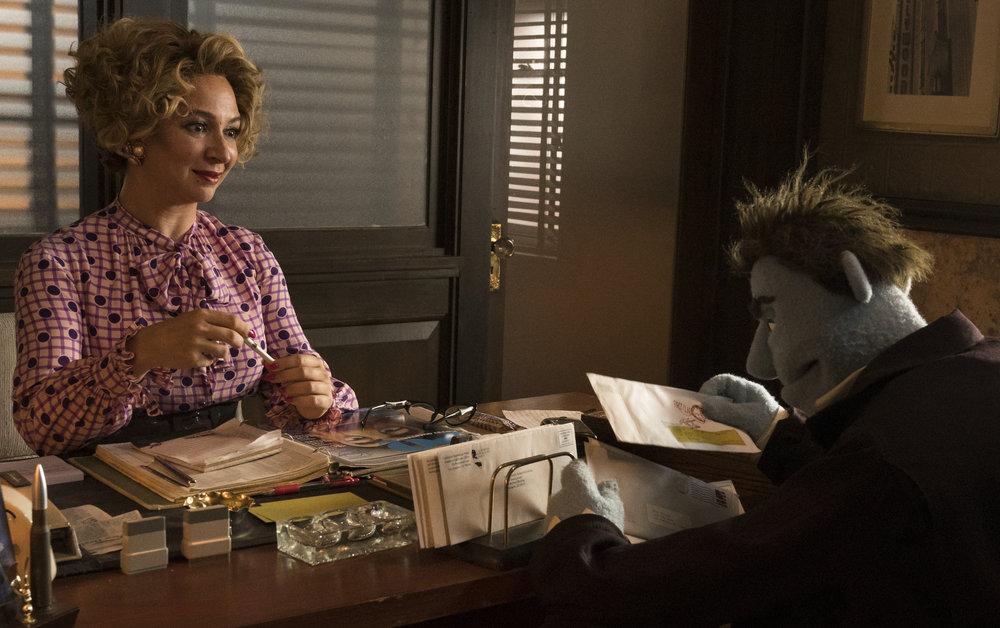 "Bubbles (Maya Rudolph) is the loyal secretary to Phil Philips (performed by puppeteer Bill Barretta), a private eye in the raunchy puppet-based comedy ""The Happytime Murders."" (Photo by Hopper Stone, courtesy STX Films)"