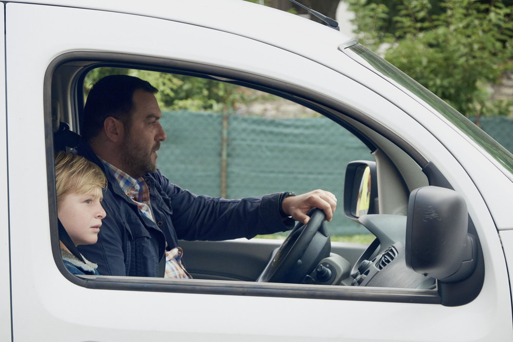 """Julien (Thomas Gioria, left) is a reluctant companion to his father, Antoine (Denis Ménochet), during a bitter divorce, in the French drama """"Custody."""" (Photo courtesy Kino Lorber)"""