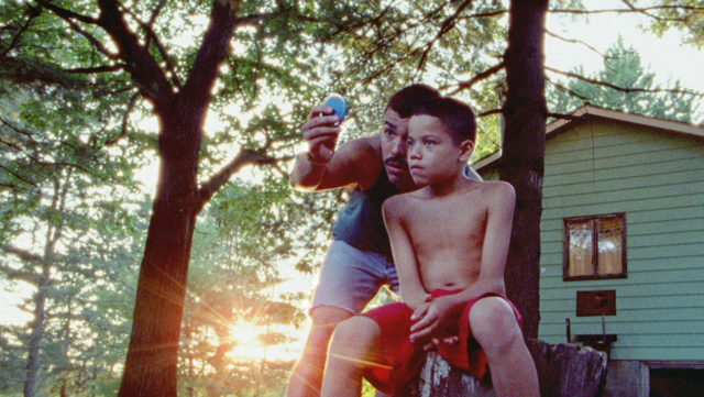 """Jonah (Evan Rosado, right) gets a haircut from his father, Paps (Raúl Castillo), in a moment from the family drama """"We the Animals."""" (Photo courtesy The Orchard)"""