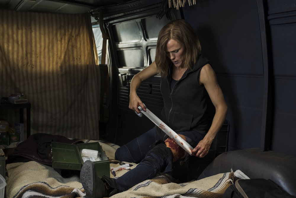 """Riley North (Jennifer Garner) patches herself up after a bloody fight, in the revenge thriller """"Peppermint."""" (Photo courtesy STX Films)"""