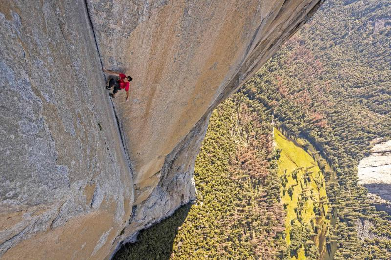 "Climber Alex Honnold works to climb the face of El Capitan at Yosemite National Park in California, without aid of ropes, in the documentary ""Free Solo."""