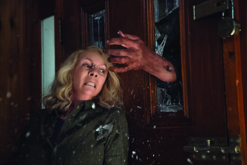 "Laurie Strode (Jamie Lee Curtis) fights off Michael Myers once again in ""Halloween,"" a continuation of the story begun in John Carpenter's 1978 horror classic. (Photo by Ryan Green, courtesy Universal Pictures)"
