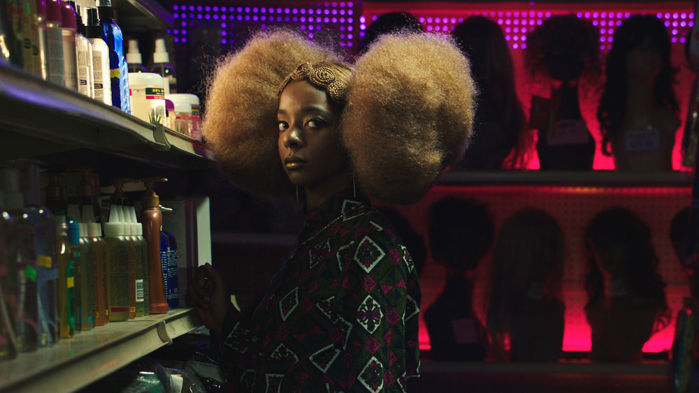 "A young woman (Kara Young) suspects something sinister in her favorite Brooklyn hair salon in Mariama Diallo's horror satire ""Hair Wolf,"" one of the films screening in the Sundance Short Film Tour 2018. (Photo by Chalotte Hornsby, courtesy Sundance Institute)"