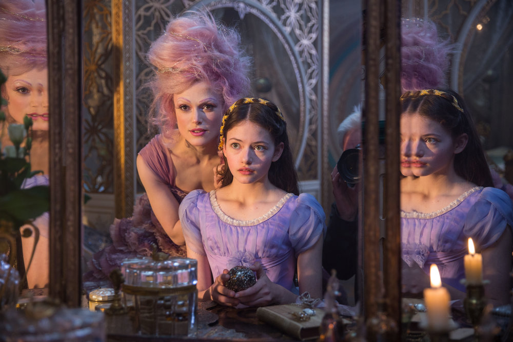 """The Sugar Plum Fairy (Keira Knightley, left) helps give a makeover to Clara (Mackenzie Foy), who has landed in a magical land, in Disney's """"The Nutcracker and the Four Realms,"""" a movie adaptation of the Christmas classic. (Photo courtesy Walt Disney Pictures)"""