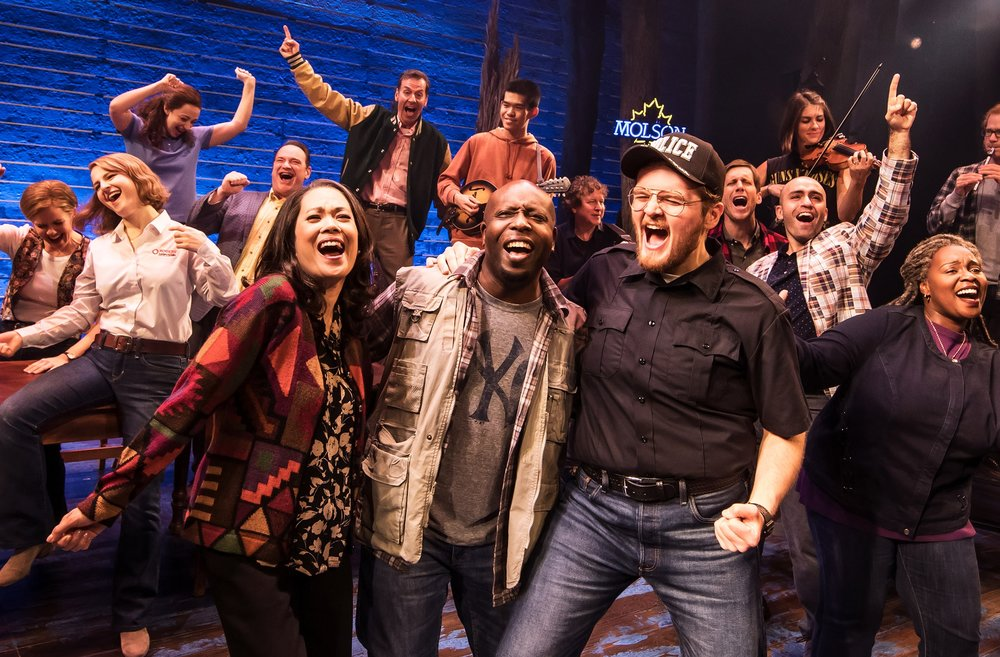 "Locals and out-of-town airline passengers bond when 38 jetliners are forced to land in Gander, Newfoundland, on 9/11, in the musical ""Come From Away."" The national touring production plays at the Eccles Theater in Salt Lake City, Nov. 6-11. (Photo by Matthew Murphy, courtesy Broadway at the Eccles)"