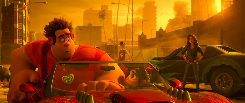 "Ralph (left, voiced by John C. Reilly) and Vanellope (center, voiced by Sarah Silverman) encounter the tough racer Shank (right, voiced by Gal Gadot) in a scene from Disney's animated comedy ""Ralph Breaks the Internet."" (Photo courtesy Walt Disney Pictures.)"