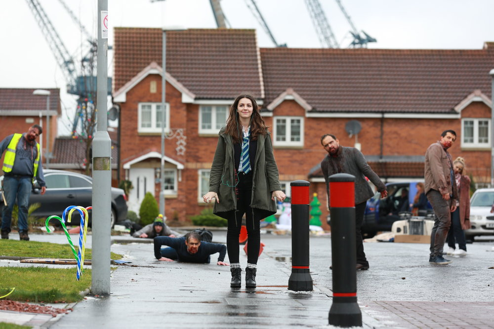 """Anna (Ella Hunt, center) greets a new day in her Scottish town — one filled with zombies — in the horror musical """"Anna and the Apocalypse."""" (Photo courtesy Orion Pictures)"""