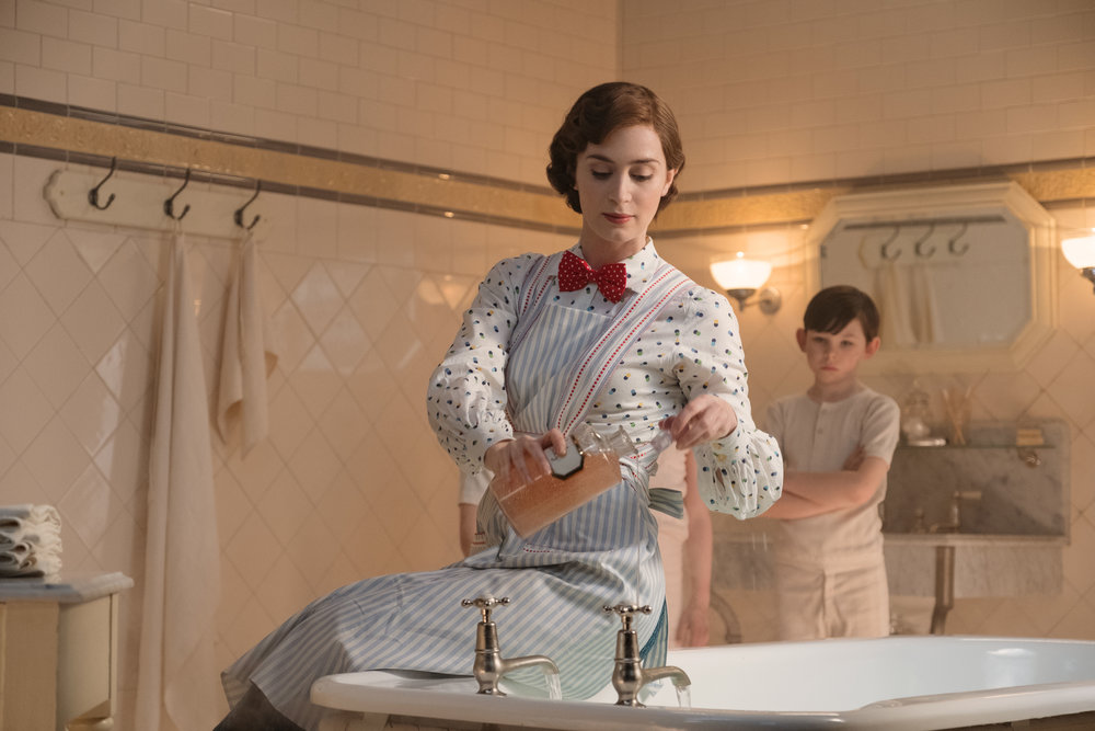 """Mary Poppins (Emily Blunt) prepares a bubble bath for a new generation of Banks children, in """"Mary Poppins Returns."""" (Photo courtesy Walt Disney Pictures)"""