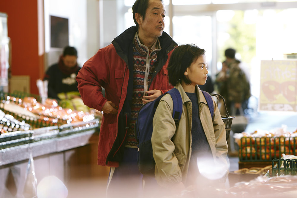 """Osamu (Lily Franky, left) and Shota (Jyo Kairi) run an efficient scam to steal from a supermarket in Kazuhiro Kore-Eda's drama """"Shoplifters."""" (Photo courtesy Magnolia Pictures)"""