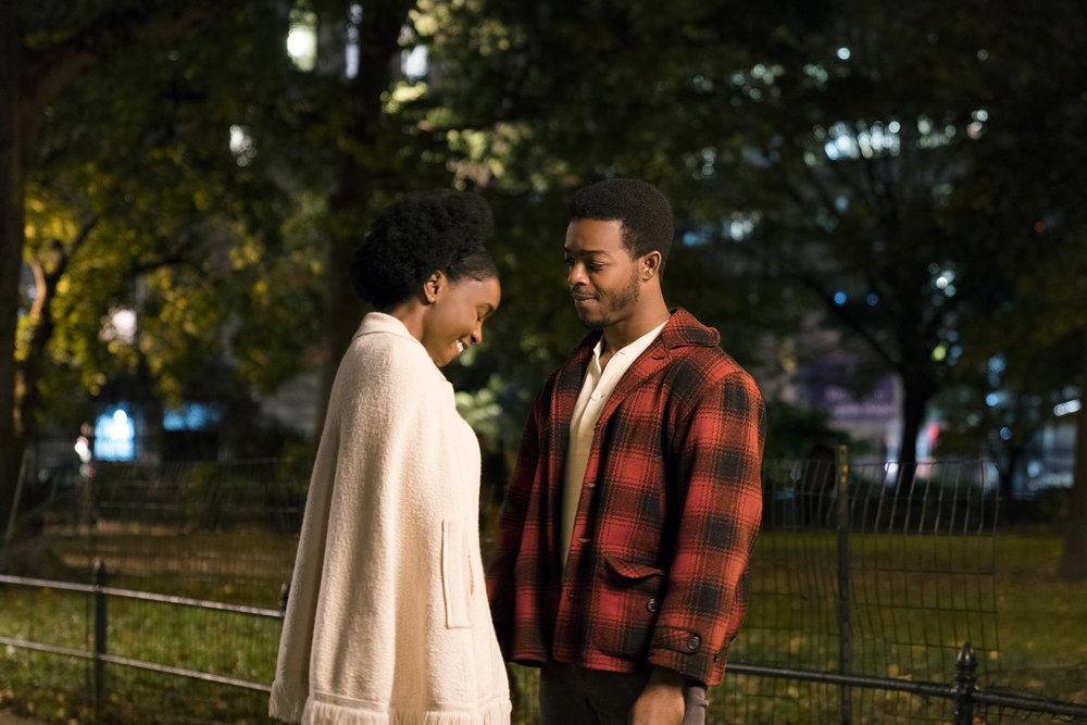 "Tish (Kiki Layne, left) and Fonny (Stephan James) are young and in love in 1970s Harlem, in writer-director Barry Jenkins' ""If Beale Street Could Talk,"" an adaptation of James Baldwin's novel. (Photo by Tatum Mangus, courtesy Annapurna Pictures)"
