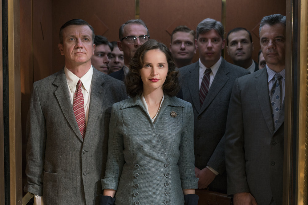 "Felicity Jones, center, stars as Ruth Bader Ginsburg in the biographical drama ""On the Basis of Sex."" (Photo by Jonathan Wenk, courtesy of Focus Features)"