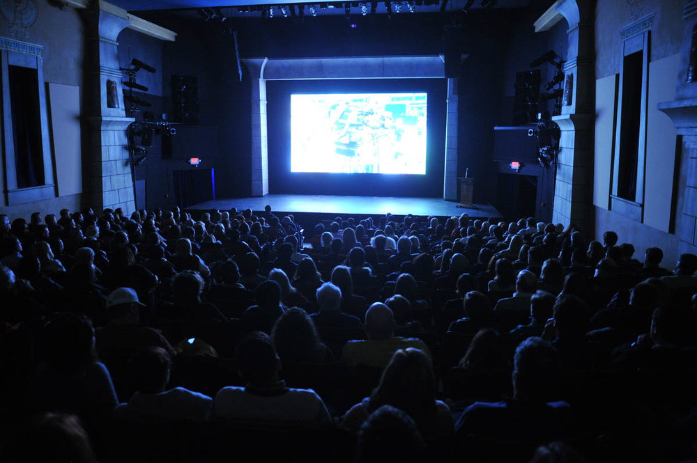 """An audience watches the premiere of """"The Workers Cup"""" in Park City's Egyptian Theatre at the 2017 Sundance Film Festival. (Photo by Stephen Speckman, courtesy Sundance Institute)"""