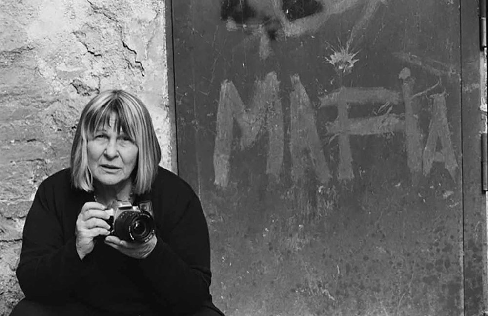 """Photographer Letizia Battaglia, who for decades has captured life in Sicily, including mob violence, is the subject of Kim Longinotto's """"Shooting the Mafia,"""" an official selection in the World Cinema Documentary Competition of the 2019 Sundance Film Festival. (Photo courtesy Sundance Institute)"""