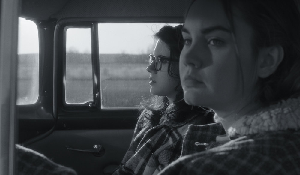 """Two teen girls (Kara Hayward, left, and Liana Liberato) begin an intimate relationship in 1960s Oklahoma, in """"To The Stars,"""" by Martha Stephens, an official selection in the U.S. Dramatic Competition of the 2019 Sundance Film Festival. (Photo by Andrew Reed, courtesy Sundance Institute)"""