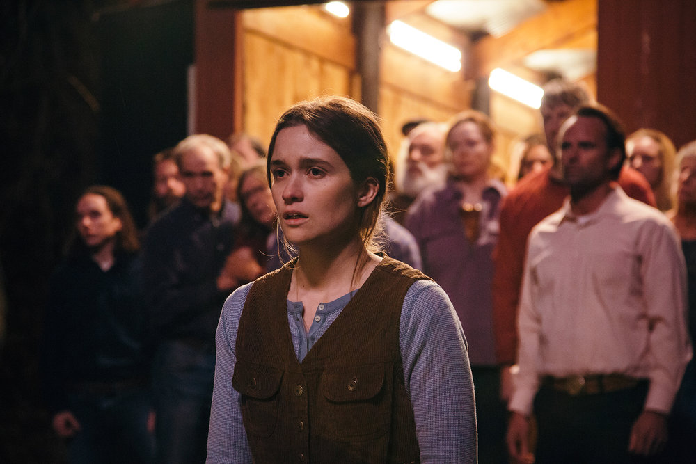 "Alice Englert, center, plays Maura, dutiful daughter of Lemuel (Walton Goggins, right), the pastor in a church that believes in snake handling, in ""Them That Follow,"" an official selection in the U.S. Dramatic Competition of the 2019 Sundance Film Festival. (Photo by Julius Chiu, courtesy Sundance Institute)"
