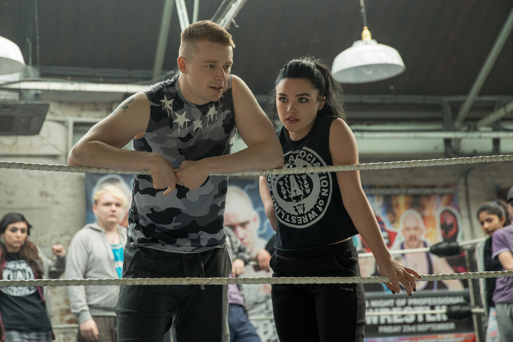 "Florence Pugh, right, plays Paige, the WWE star who came up from a hardscrabble wrestling life in Norwich, England, with her brother Zak (Jack Lowden, left), as depicted in the comedy-drama ""Fighting With My Family."" (Photo by Robert Viglasky, courtesy Metro Goldwyn Mayer Pictures)"