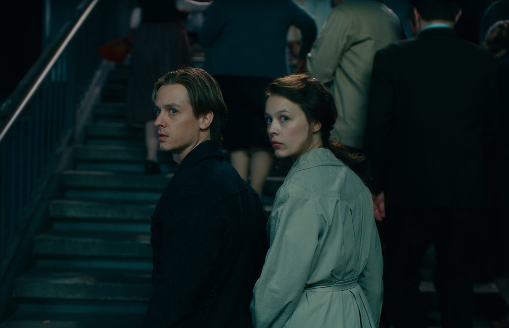"""Painter Kurt Barnert (Tom Schilling, left) and his fashion designer wife Ellie (Paula Beer) attempt to escape East Berlin in 1961, months before the Berlin Wall is built, in the drama """"Never Look Away."""" (Photo by Caleb Deschanel, courtesy Sony Pictures Classics)"""