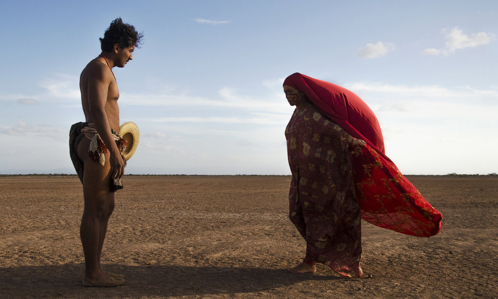 """Rayapet (José Acosta, left) dances with his prospective bride, Zaina (Natalia Reyes), following the traditions of Colombia's indigenous Wayuu people, in the drama """"Birds of Passage."""" (Photo courtesy The Orchard)"""