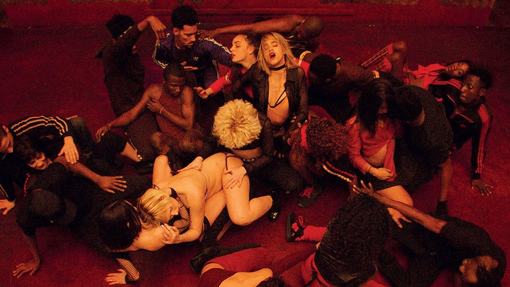 """A troupe of dancers, led by Selva (Sofia Boutella, center) hits performative ecstasy in a scene from director Gaspar Noë's confrontational """"Climax."""" (Photo courtesy A24)"""