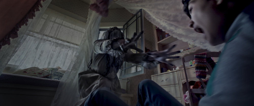 "The evil spirit La Llorona (Marisol Ramirez) tries to grab Chris (Roman Christou) in a scene from the horror thriller ""The Curse of La Llorona."" (Photo courtesy Warner Bros. Pictures / New Line Cinema.)"