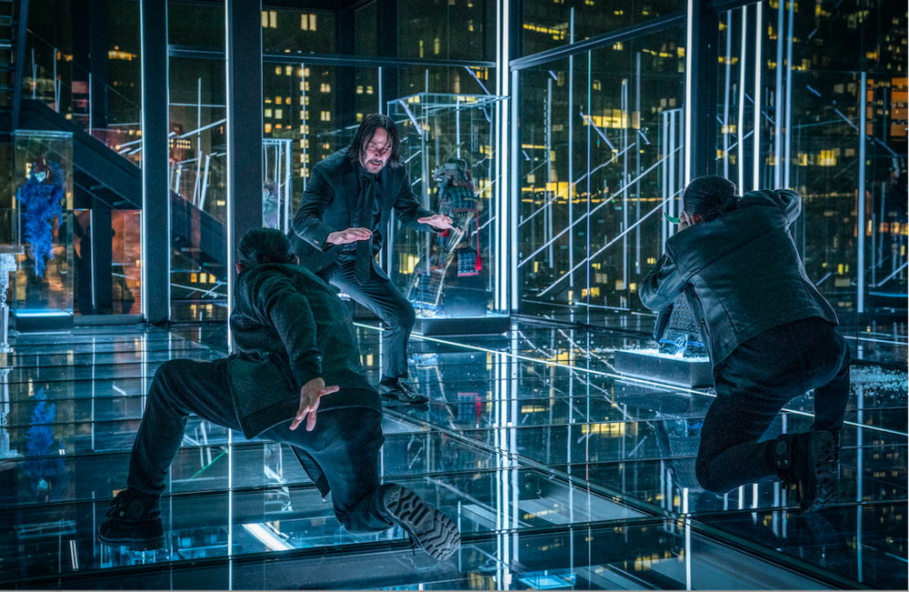 """World-weary assassin John Wick (Keanu Reeves) battles two tough fighters, in a scene from """"John Wick, Chapter 3: Parabellum."""" (Photo courtesy Lionsgate.)"""