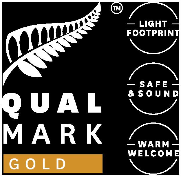 Qualmark Gold Award Logo Stacked Reverse.png