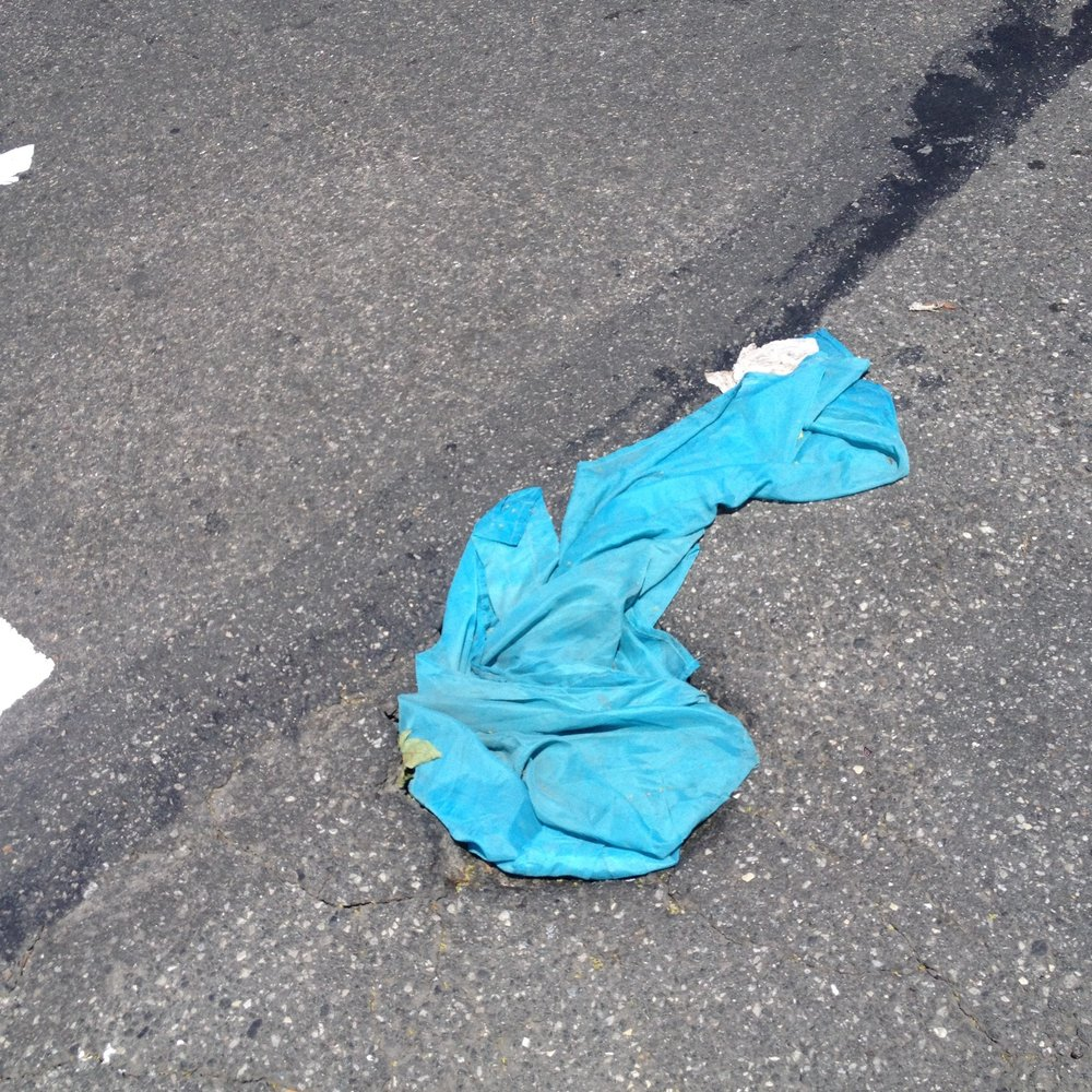 Riding my bike to the studio, I passed this blue fabric nestling into and flowing out of a hole in the street. It looks like it could be a curtain, of the kind you can get in the dollar stores.