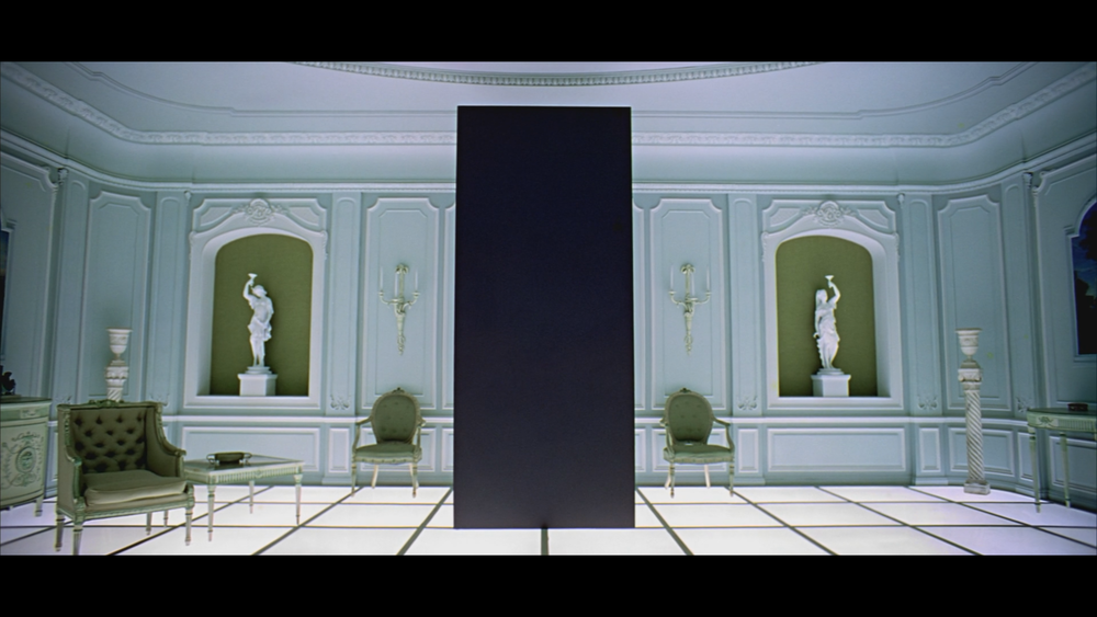 The monolith stands in front of Dave Bowman's deathbed, waiting to take humanity to the next step in evolution.