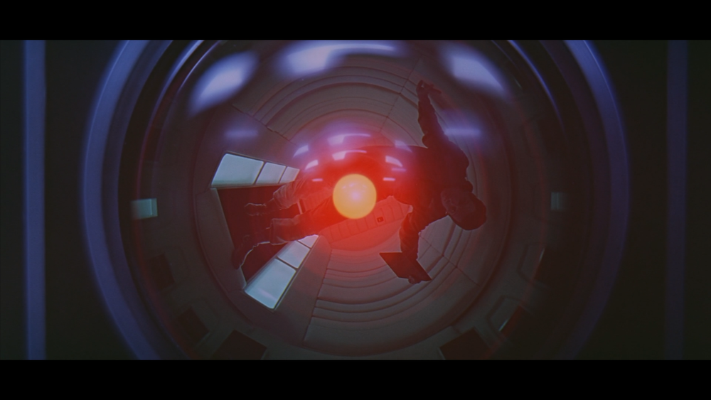 Dr. Dave Bowman, played by Keir Dullea, is reflected off HAL, the sentient computer that controls the systems of  Discovery One .