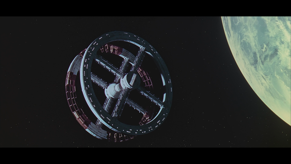One of the opening shots in space following the man ape scenes.  I love the way the revolving space station gracefully glides closer to the screen to the sound of classical music. Also take note of how light and shadow ellegantly move as the space station rotates.