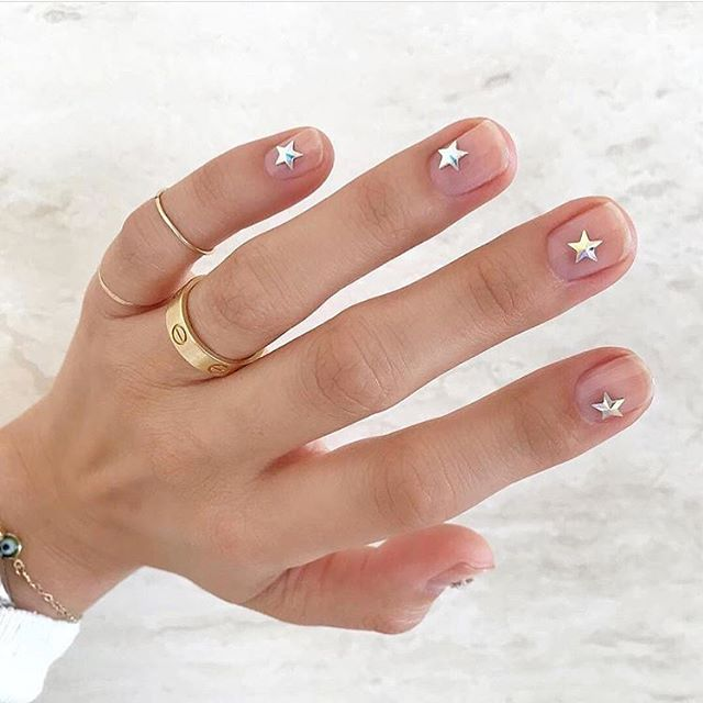 That's one way to keep your nails nude but dressed up 💁🏻‍♀️ Get this look in nail art form or stickers. via @betina_goldstein
